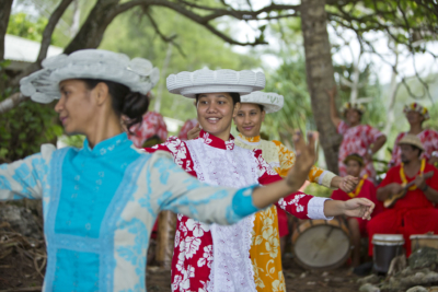 Traditional dancers and musicians in Rurutu