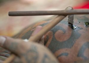 Making atraditional tatoo