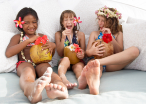 Kids drinking coconut juice in a sofa at Bora Bora Four Seasons Resort