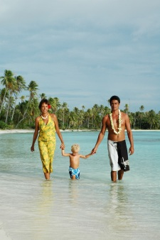 Family stroll on a Motu (white sand islet)