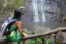 Woman looking at Waterfalls in Moorea