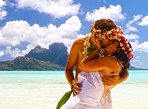 Couple kissing in front of Otemanu mount on Bora Bora island